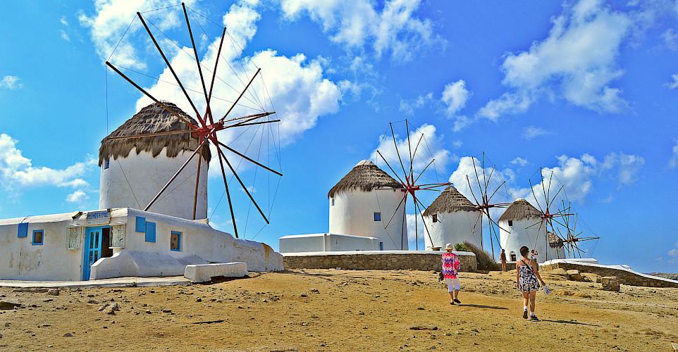 Famous windmills above Mykonos on Mykonos Island, Greece. Photo via Flickr:Ira Gelb
