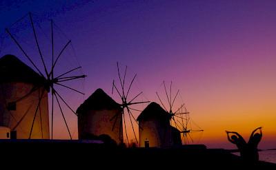 Mykonos Island windmills at sunset, Cyclades Islands, Greece. Photo via Flickr:Hassan Rafeek