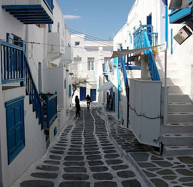 Blue and white architecture on Mykonos Island, Greece. Photo via Wikimedia Commons:Joanbanjo