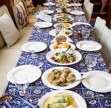 Traditional Greek food on board the Panagiota, Cyclades Islands bike tour.