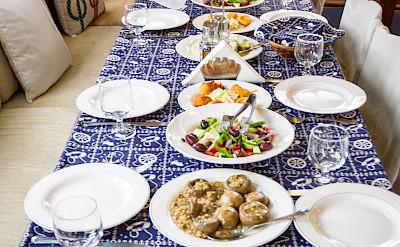 Traditional Greek food on board the Panagiota, Cyclades Islands bike tour.