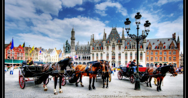 Horsedrawn carriages in Bruges. Photo via Flickr:Wolfgang Staudt