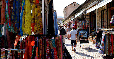 Shopping in Mostar in Bosnia-Herzegovina. Photo via Flickr:Pero Kvrzica