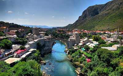 Mostar, a UNESCO Site, on the Neretva River with its most famous bridge in Bosnia-Herzegovina. Photo via Flickr:Kevin Botto