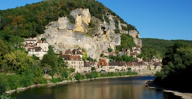 La Roque Gageac along the Dordogne River, France. Photo via Flickr:Stephane Mignon