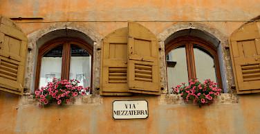 Facades in Belluno, Italy. Photo via Flickr:Irene Grassi