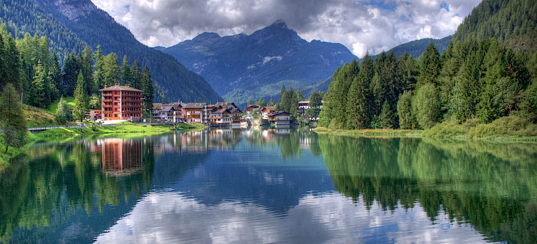 Lake Alleghe in the Dolomiti Bellunesi National Park, Belluno, Veneto, Italy. Photo via Wikimedia Commons:Roberto Ferrari
