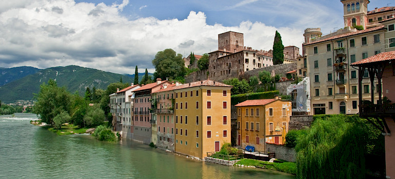 Biking through Bassano del Grappa, Italy. Photo via Flickr:Graeme Churchard