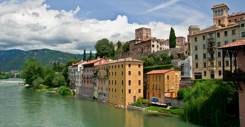 Biking through Bassano del Grappa, Italy. Photo via Flickr:Graeme Churchard