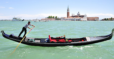 Gondolas await in Venice, Italy.
