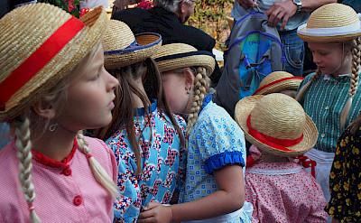 Girls all dressed up in Schagen in the region of West Friesland, Holland. Photo via Flickr:Hans Griep