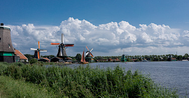 Windmills and bike paths make up North Holland in the Netherlands. Photo via Flickr:Kismihok