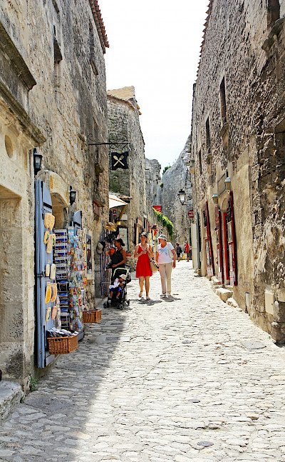 Shopping alley in Les Baux de Provence, France. Flickr:Andrea Schaffer