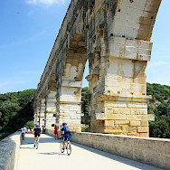 Biking along the Pont du Gard in Provence, France. Flickr:Andrea Schaffer