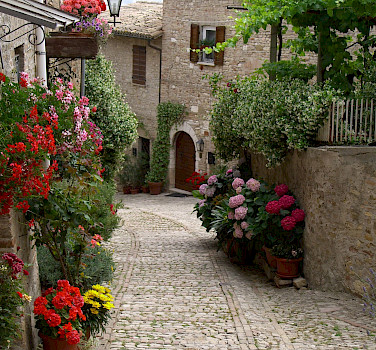 Cobblestoned streets in Montefalco, Umbria, Italy. Photo via Flickr:Deanna Keahey