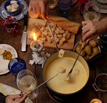 Cheese fondue is a Swiss favorite. Photo via Flickr:Juliano Mendes