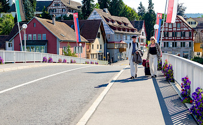 Crossing the bridge to Stein am Rhein, Switzerland. Photo via Flickr:Luca Casartelli