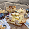 Wine & cheese board in France perhaps. Flickr:Joe deSousa