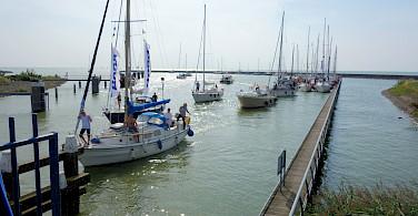Boats returning in Stavoren on the IJsselmeer, the Netherlands. Photo via Flickr:dassel
