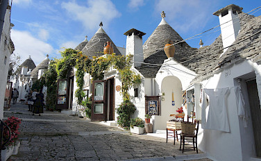 The famous <i>trulli</i> in Alberobello, Puglia, Italy. Photo via Flickr:Guldem Ustun