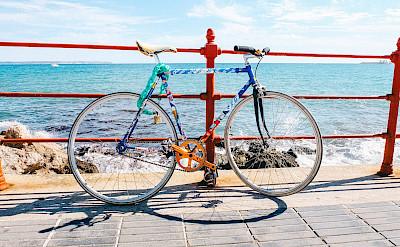Biking along the beach in Mallorca, Spain. Flickr:Jörg Schubert