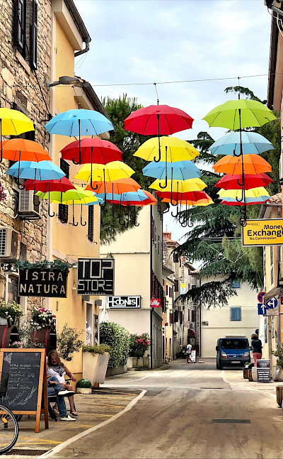 Umbrellas in Novigrad, Istria, Croatia. Flickr:aiva.