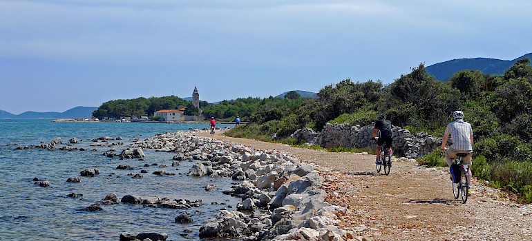 Biking along the coast in Kvarner Bay, Croatia.
