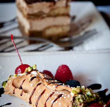 Tiramisu or cannoli with espresso or wine - this is a bike tour in Italy! Photo via Flickr:Alexis Fam Photography