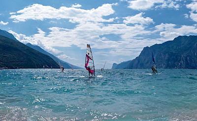 Windsurfing on Lake Garda, Italy. Photo via Flickr:Andrea Santoni