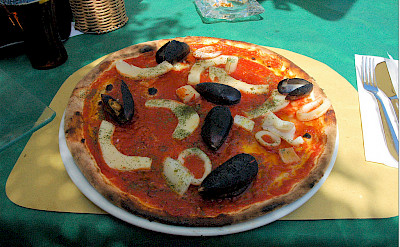Seafood pizza in Peschiera del Grapa, Italy. Photo via Flickr:Janos Korom Dr