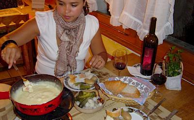 Cheese fondue is a favorite in Switzerland. Flickr:Luis Beltran