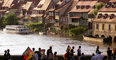 "Football fans passing ""Little Venice,"" Bamberg, Germany. Photo via Flickr:Alan Bruce"