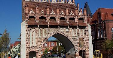 Gothic Town Gate in Malchin, Germany. Photo via Wikimedia Commons:Ch Pagenkopf