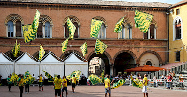 Flag throwing festival in Ferrara, Emilia-Romagna, Italy. Photo via Flickr:Xiquinho Silva