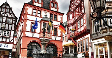 Discover Bernkastel Keus as you bike along the Moselle River. Photo via Flickr:Bert Haufmann