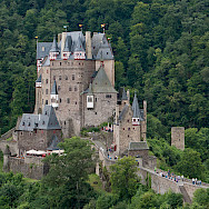 Eltz Castle above the Mosel River between Koblenz and Trier, Rhineland-Palatinate, Germany. Photo via Wikimedia Commons:Steffen Schmitz