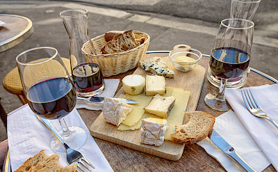 Wine, cheese and bread board in Paris, France. Flickr:Joe deSousa