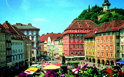 Graz's main square with Clocktower above. Photo via Austrian National Tourist Office