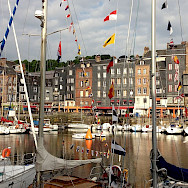 Popular tourist destination, the Honfleur harbor in Normandy, France. Flickr:Julien Maury