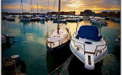 Boats in Normandy harbor. Photo via Flickr:Moyan Brenn