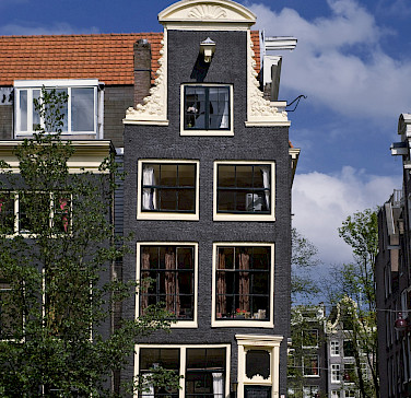 Biking along Prinsengracht in Amsterdam. Photo courtesy of the Netherlands Board of Tourism
