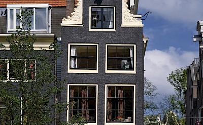 Biking along Prinsengracht in Amsterdam. Photo via Netherlands Board of Tourism