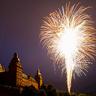 Fireworks highlighting the glory of the Schloss in Aschaffenburg, Germany. Flickr:Carsten Frenzl