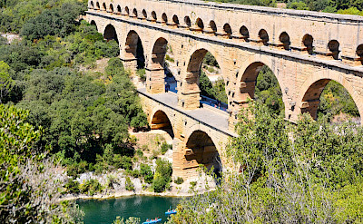 Bikers and kayakers at the Pont du Gard on the Gardon River in Provence region of France. Flickr:Mike McBey