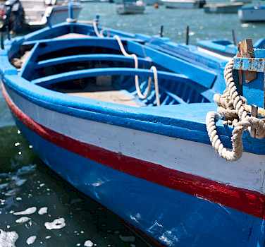 Boats docked in Marzamemi, Sicily, Italy. Photo via Flickr:sporkist