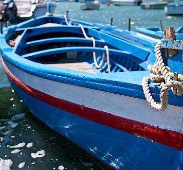 Boats docked in Marzamemi, Sicily, Italy. Photo via Flickr:sporkist