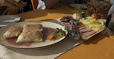 Slovenia lunch of cheese dumplings and cold cuts. Photo via Flickr:claire rowland