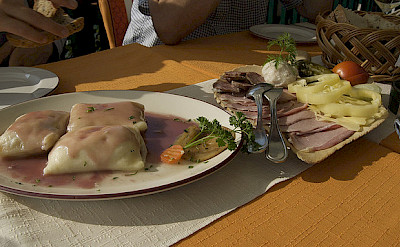 Slovenia lunch of cheese dumplings and cold cuts. Flickr:claire rowland