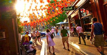 Beer & biking in sunny Amsterdam, North Holland, the Netherlands. Photo via Flickr:Moyan Brenn
