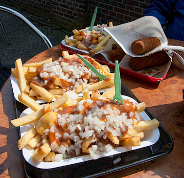 "Dutch fries with curry ketchup, onions and ""kroketten."" Photo via Flickr:vitamindave"